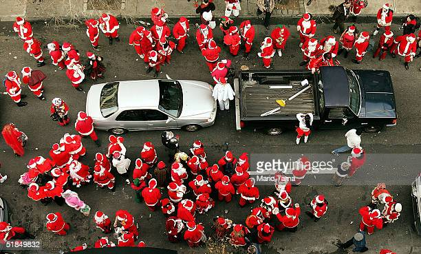 Hundreds of Santa Claus' participate in the 2004 Santacon while slowing down traffic on 44th Street December 11 2004 in New York City The annual...