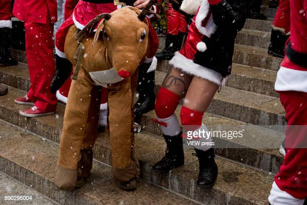 Hundreds of Santas gather at the Post Office steps in Manhattan to celebrate the annual SantaCon event in December 9 2017 in New York City