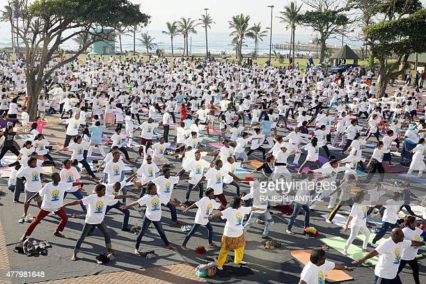 Hundreds of school learners take part in a yoga session as part of the International Day of Yoga at the amphitheatre lawns at the North Beach on June...