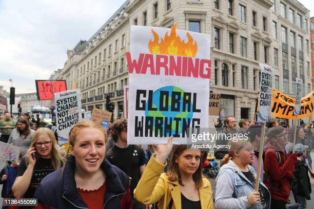 Hundreds of schoolchildren march from Parliament square to Oxford Circus in protest of climate change in central London England on 12 April 2019...