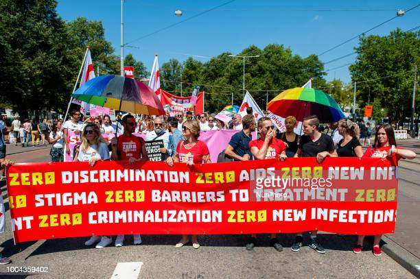 Hundreds of scientists and activists walk this Monday July 23rd in Amsterdam during the AIDS March to demand access to HIV treatments Access to...