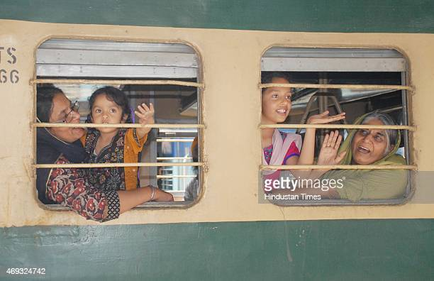 Hundreds of Sikh pilgrims wave from the special Pakistani train as they leave for Lahore to celebrate Baisakhi festival in Pakistan from Amritsar...