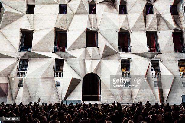 Hundreds of spectators follow the 3D Mapping 'Axioma' by 'Onionlab' during the city's light festival 'Llum BCN' in Barcelona