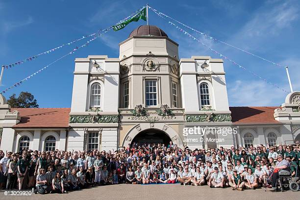 Hundreds of staff and volunteers pose for a group photo outisde the entrance during birthday celebrations at Taronga Zoo on October 7, 2016 in...