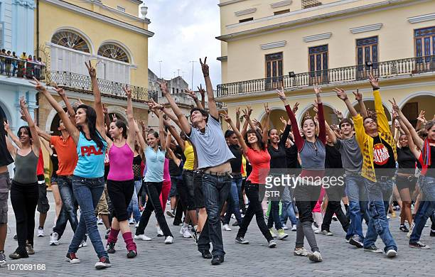 Hundreds of students dance during a 'flashmob' in commemoration of the UNICEF Convention on the Rights of the Child at a square in Havana on November...