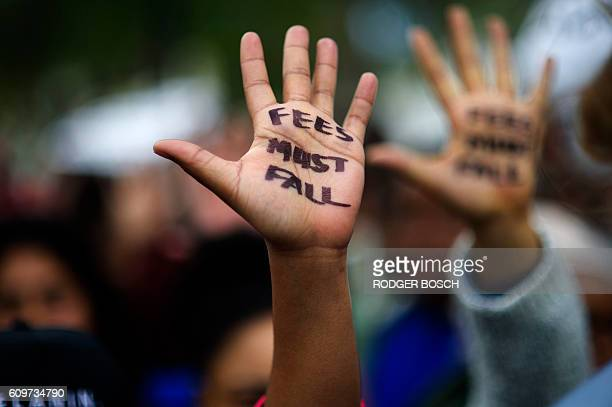 Hundreds of students hold a protest over student fee increases on September 22 2016 outside the South African parliament in Cape Town Student groups...