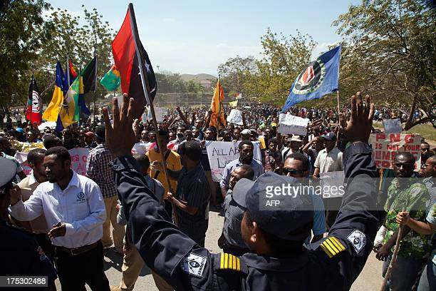 Hundreds of students march towards the university gate in Port Moresby on August 2 during a protest rally against Australia and PNG's asylum seeker...