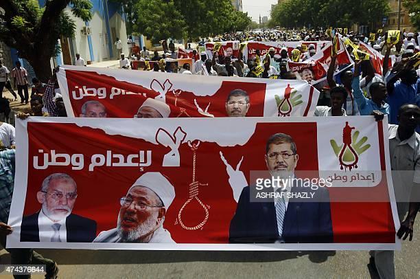 Hundreds of Sudanese Islamists hold posters bearing portraits of Egypt's ousted president Mohamed Morsi Egyptian Muslim Brotherhood leader Mohamed...