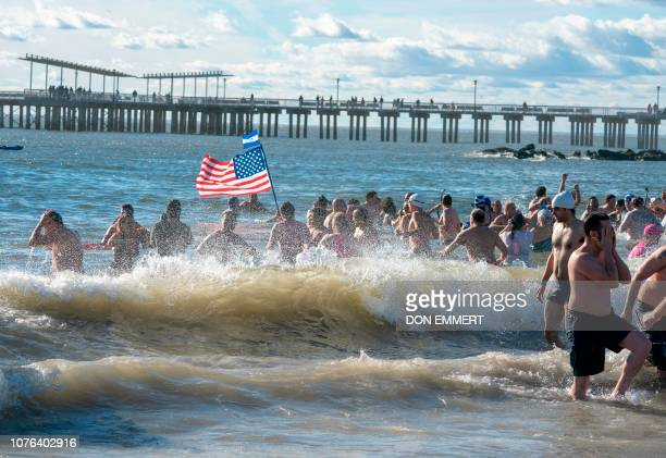 Hundreds of swimmers run into the water to take part in the annual Coney Island Polar Bear Club New Year's Day Plunge January 1 2019 on Coney Island...