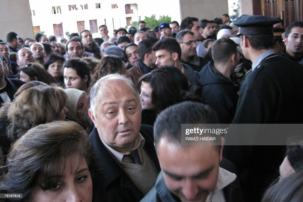 Hundreds of Syrians queue outside the main gate of the Opera House in Damascus 24 January 2008 to buy tickets for Fairuz's first concert in Syria in 22 years. The veteran Lebanese diva and her troupe crossed the border from Lebanon into Syria yesterday to start reheasrals on her musical play 'Sah El-Nom' which will be presented next week in Damascus, chosen as this year's cultural capital of the Arab world, after being performed in Lebanon in 2006 and in Jordan last year. The Rahbani Brothers musical was first presented in Syria and Lebanon in the early 1970s.