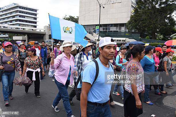 Hundreds of teachers demonstrate along the streets of Guatemala City on August 26 2015 demanding improvements in the recruitment of teachers as a...