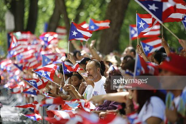 Hundreds of thousands filled the streets of Manhattan Brooklyn to celebrate NYC's 59th annual Puerto Rico Day starting with a parade led by mayor...
