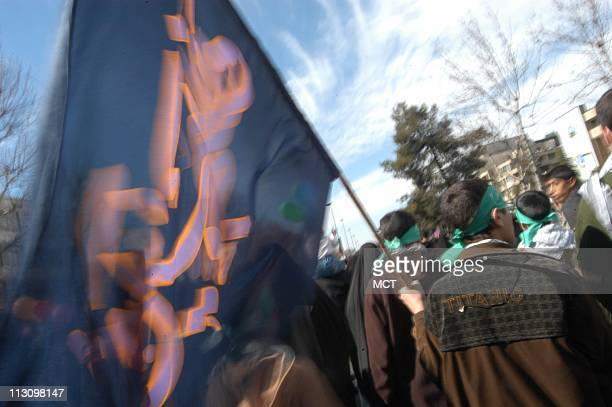 TEHRAN IRAN Hundreds of thousands Iranians turned out at the rally at Azadi or 'Freedom' Square in western Tehran carrying banners lauding Islamic...