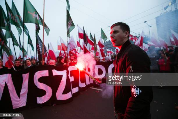 Hundreds of thousands march to celebrate Polish independence in Warsaw . One of the leaders form All-Polish Youth keep the flar on November 11, 2018...