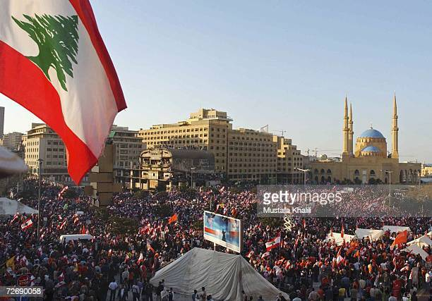 Hundreds of thousands of demonstrators gather in the streets in front of the Serail, the Prime Minister's offices, on December 1 in downtown Beirut,...