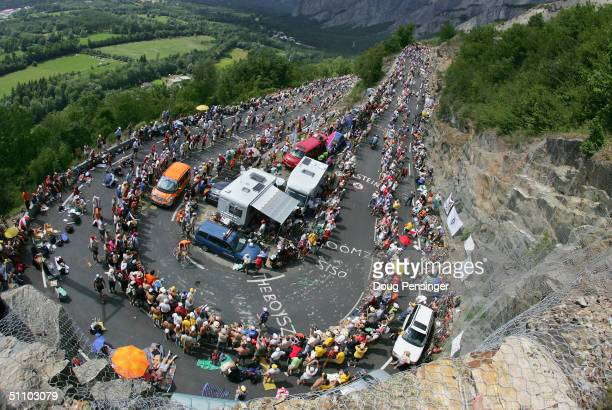 L'ALPE D'HUEZ FRANCE JULY 21 Hundreds of thousands of fans crowd the course as Lance Armstrong of the USA and riding for US Postal Service presented...