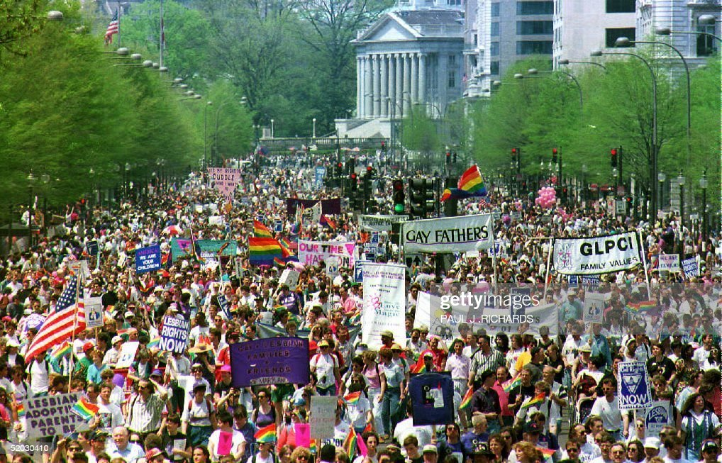 Hundreds of thousands of gay-rights demonstrators march down Pennsylvania Avenue in downtown Washington D.C. 25 April 1993. The march, which is expected to attract one million people, aims at prompting legislation prohibiting all forms of anti-homosexual discrimination and a surge of new support for AIDS research.
