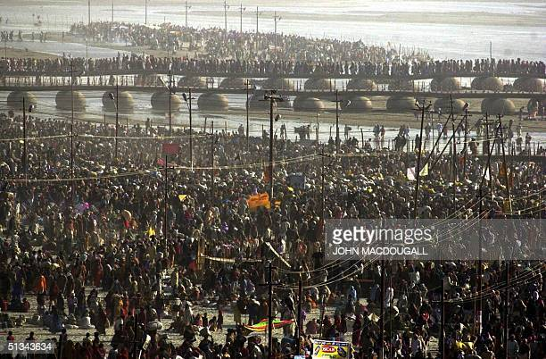 Hundreds of thousands of Hindu devotees crowd the banks of the Ganges 24 January 2001 during the Kumbh Mela Millions of devotees bathed on the most...