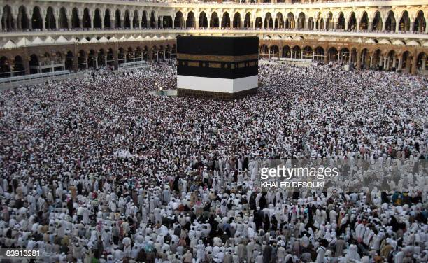Hundreds of thousands of Muslim pilgrims perform the Tawaf ritual around the Kaaba at Mecca's Grand Mosque on December 4 2008 as Muslims from all...