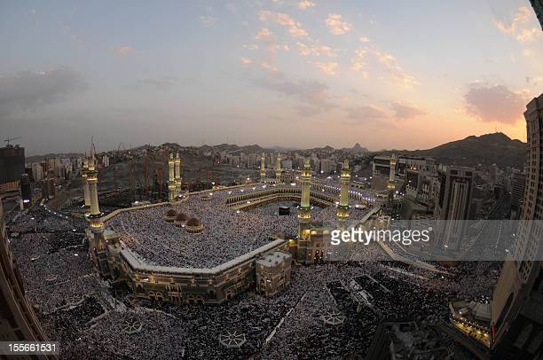 Hundreds of thousands of Muslims perform the early morning Eid AlFitr prayer in the Saudi holy city of Mecca on September 10 2010 as Muslilms around...