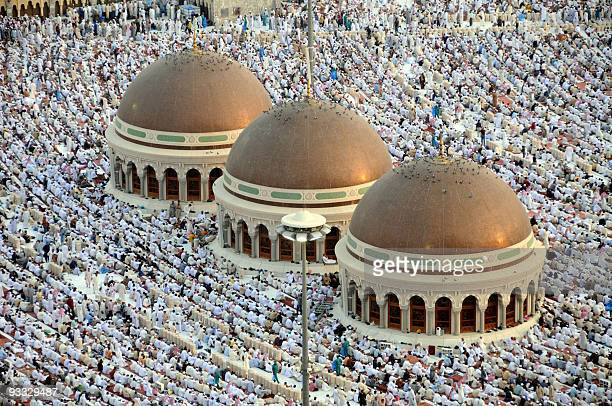 Hundreds of thousands of Muslims perform the early morning Eid AlFitr prayers at the alHaram Grand Mosque in the Saudi holy city of Mecca on...