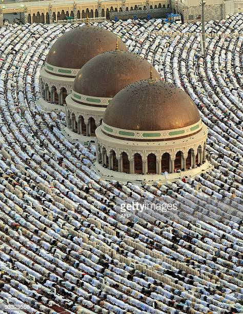 Hundreds of thousands of Muslims perform the early morning Eid alFitr prayer at the Masjed AlHaram grand mosque in the Saudi holy city of Mecca on...