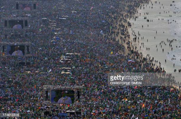 Hundreds of thousands of people crowd Copacabana beach in Rio de Janeiro on July 28 2013 waiting for the arrival of Pope Francis for the final mass...