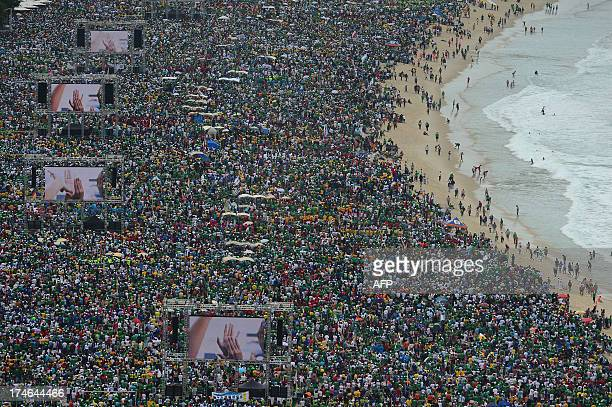 Hundreds of thousands of people crowd Copacabana beach in Rio de Janeiro on July 28 2013 as Pope Francis celebrates the final mass of his visit to...