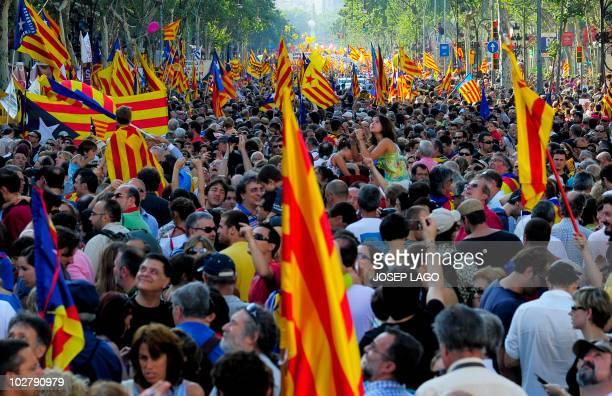 Hundreds of thousands of people hold the Catalan flag as they march on July 10 2010 in Barcelona in support of the Catalan region's statute of...
