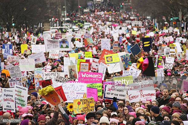 Hundreds of thousands of people take part in the Women's March in Washington on Jan 21 to protest US President Donald Trump a day after he took office