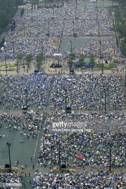 Hundreds of thousands of protesters gather in Victoria Park, July 1, 2004 for one of the territory's biggest protest march since it returned to...