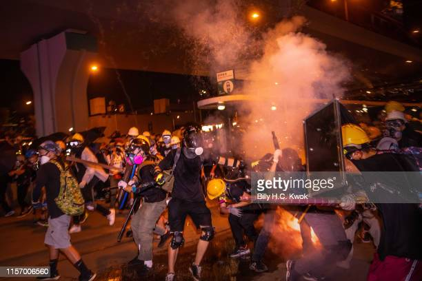 Hundreds of thousands of protesters running away from the tear gas during an antiextradition bill march in Hong Kong on July 21 2019 in Hong Kong...