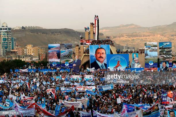 TOPSHOT Hundreds of thousands of Yemenis hold posters and portraits of Yemen's expresident Ali Abdullah Saleh during a demonstration in support of...