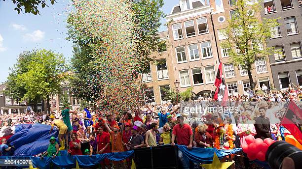 Hundreds of thousands turned out for the Canal Pride Parade in Amsterdam Hundreds of floats went through the city canals with singers dancers and all...