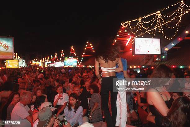 Hundreds of tourists drink at beer bars in the famous Soi Bangla, in the main red-light district in Patong, one of the main tourist streets in a...