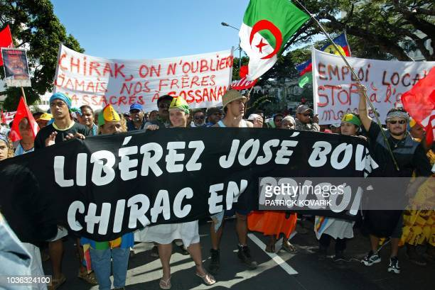 Hundreds of trade unionists demonstrate holding banners and an Algerian flag 23 July 2003 in Noumea New Caledonia calling for the release of jailed...