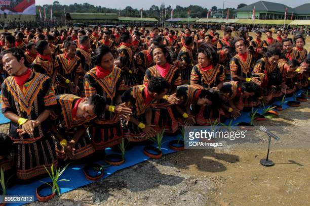 Hundreds of Traditional Saman Dancers seen performing during the opening of 'Infantry Brigade 25 Siwah' The Indonesian National Army continues to...