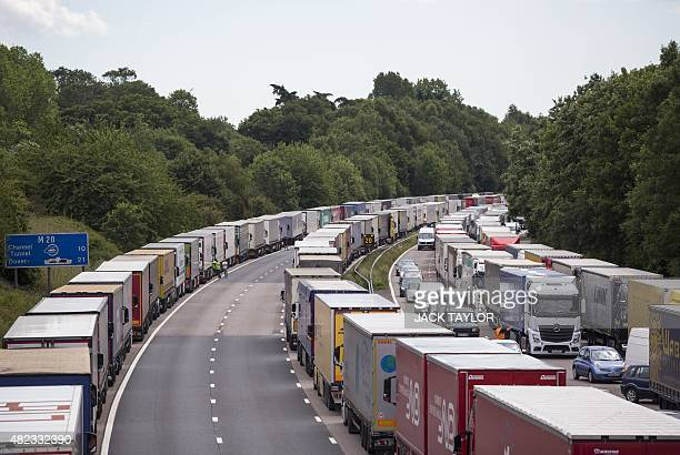 Hundreds of trucks are pictured parked on the southbound and northbound carriageways of the M20 motorway near Ashford in Kent southeast England on...