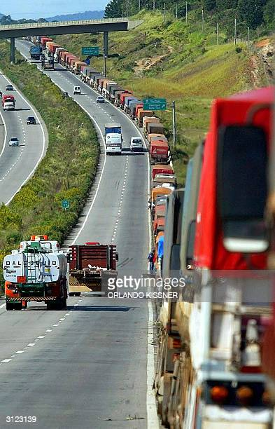 Hundreds of trucks are seen forming a queue along 70 km in the PR376 road 23 March 2004 in Parana south of Brazil Private operators of the Paranagua...