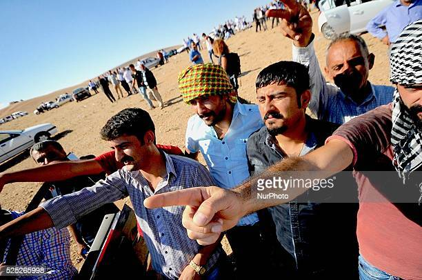 Hundreds of Turkish Kurds gathered at the border town of Suruc in Turkey. The Kurds from Turkey drove miles to see the heavy fighting going on...