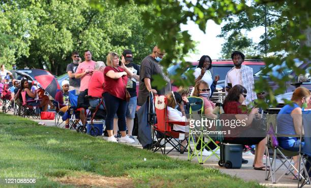 Hundreds of unemployed Kentucky residents wait in long lines outside the Kentucky Career Center for help with their unemployment claims on June 19...