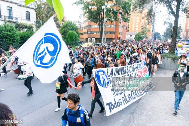 Hundreds of university students participate in the Zombie March for education in Bogota Colombia on October 31 2018 The march aims to pressure the...