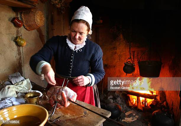 Hundreds of visitors came to Plimoth Plantation a day before Thanksgiving In the 1627 English Village Pilgrim role player Bridget Fuller seasons pork...