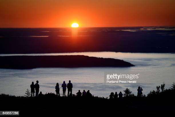 Hundreds of visitors flock to Cadillac Mountain in Acadia National Park to watch the sunrise Monday July 31 2017 At 1530 ft Cadillac Mountain is the...