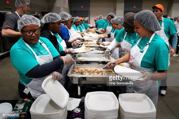 Hundreds of volunteers prepare plates of Thanksgiving dinner for more than 5,000 District of Columbia resident during The Salvation Army and...