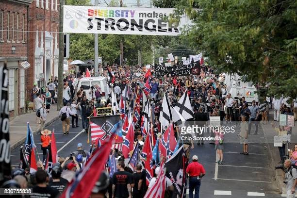 Hundreds of white nationalists neoNazis and members of the altright march down East Market Street toward Emancipation Park during the Unite the Right...