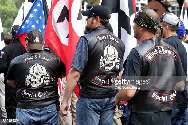 """Hundreds of white nationalists, neo-Nazis and members of the """"alt-right"""" march down East Market Street toward Emancipation Park during the United the..."""