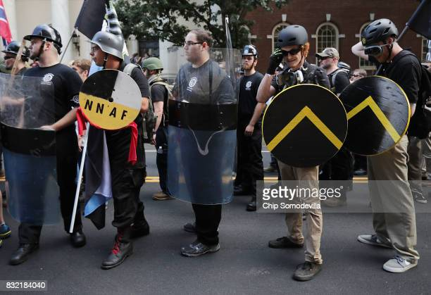 Hundreds of white nationalists neoNazis and members of the 'altright' march down East Market Street toward Emancipation Park during the United the...
