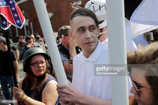 Hundreds of white nationalists neoNazis and members of the altright march down East Market Street toward Emancipation Park during the United the...