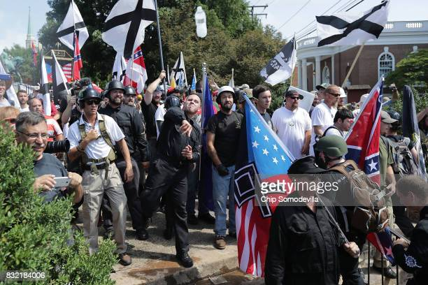 Hundreds of white nationalists neoNazis KKK and members of the altright hurl water bottles back and forth against counter demonstrators on the...